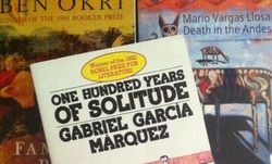 Picture of One Hundred Years of Solitude accompanied by other magical realism novels.
